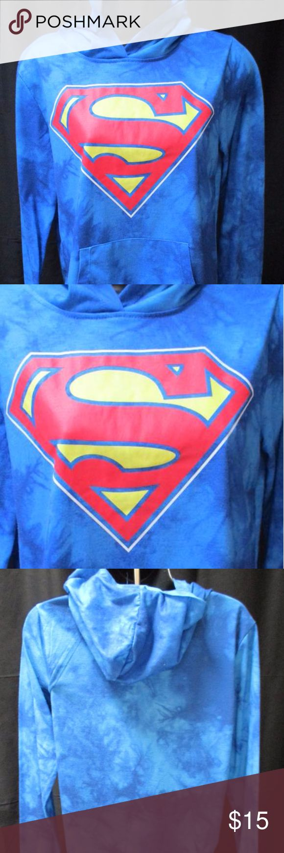 "SUPERMAN DC Comics Pullover Hoodie-Size:M-(7/9) This is a Junior Girls DC Comics Superman Pullover Hoodie. Blue with brush like strokes front to back. Very Good Pre-Owned Condition, Measurements:Shoulder to Shoulder: 16"", Armpit to Armpit: 18"", Shoulder to Hem: 24"", Sleeve Length: 25"" and Hood Length: 12/5"". Attached  hood, pullover style, 2 slip pockets in front, Superman emblem in front in colors of red/yellow/white, band on cuffs and waistband. Solid backside. Thank you for coming to…"