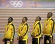 Jamaica's relay team, (L-R) Nesta Carter, Michael Frater, Yahan Blake and Usain Bolt stand on the podium after receiving gold medals for the men's 4x100m relay at the victory ceremony at the London 2012 Olympic Games at the Olympic Stadium August 11, 2012