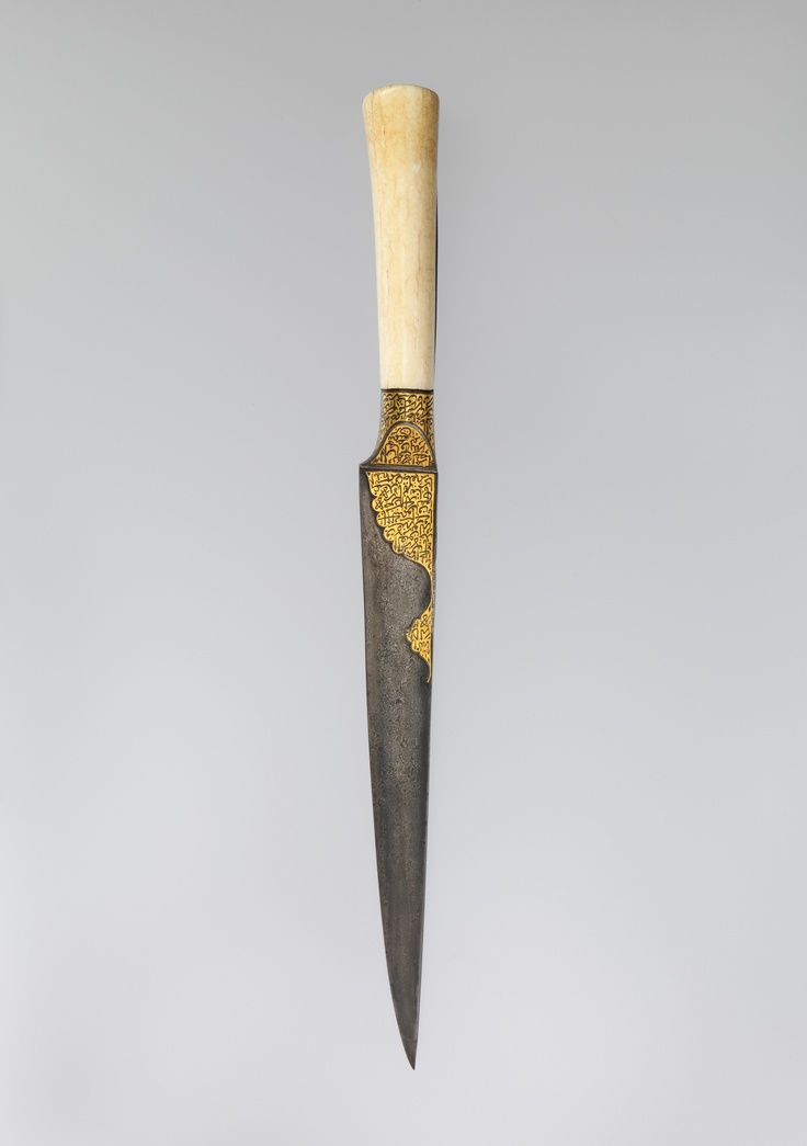 Knife with an Ivory Handle and Qur'anic Inscriptions.  Object Name:     Dagger. Date:     early 19th century. Geography:     Iran. Medium:     Hilt: walrus ivory Blade: watered steel; gold inlay.