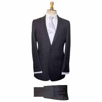 Gresham Blake Black Mohair Berwick Suit: A classic black mohair suit from our staple 'Berwick' range. The ideal suit for a special occasion.  -Slim contemporary fit -Black paisley lining with burgundy trim -Internal pockets -Double vent -Two button fastening -Pale blue melton