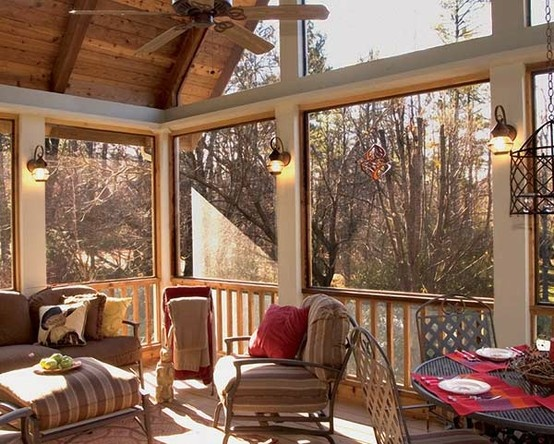 Lovely screened back porch with high gabled ceiling designed and built by Atlanta Decking & Fence.