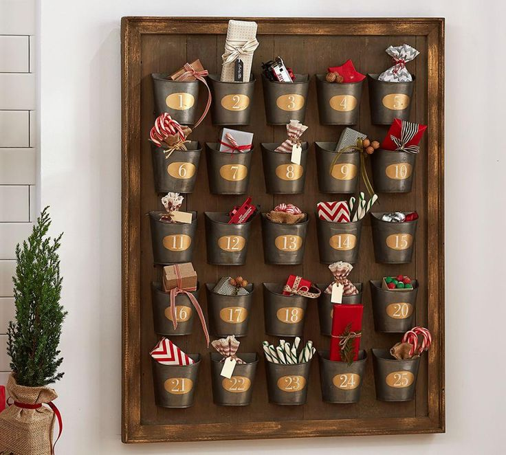 Gilt Galvanized Advent Calendar from Potter Barn. Awesome, but too expensive. Could I make something like this? Would love to plan the items for each day!