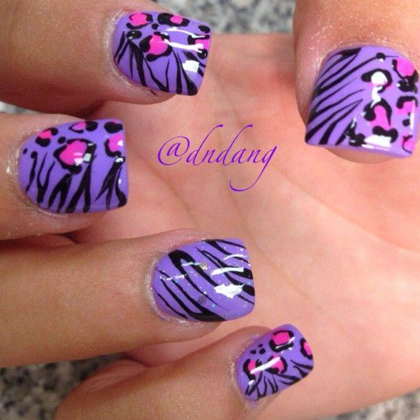 Zebra stripes &  leopard print on bright purple base nail art design