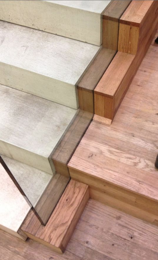Tint of glass rail creates an aesthetic shade on timber material depending on the angle viewed - Monika