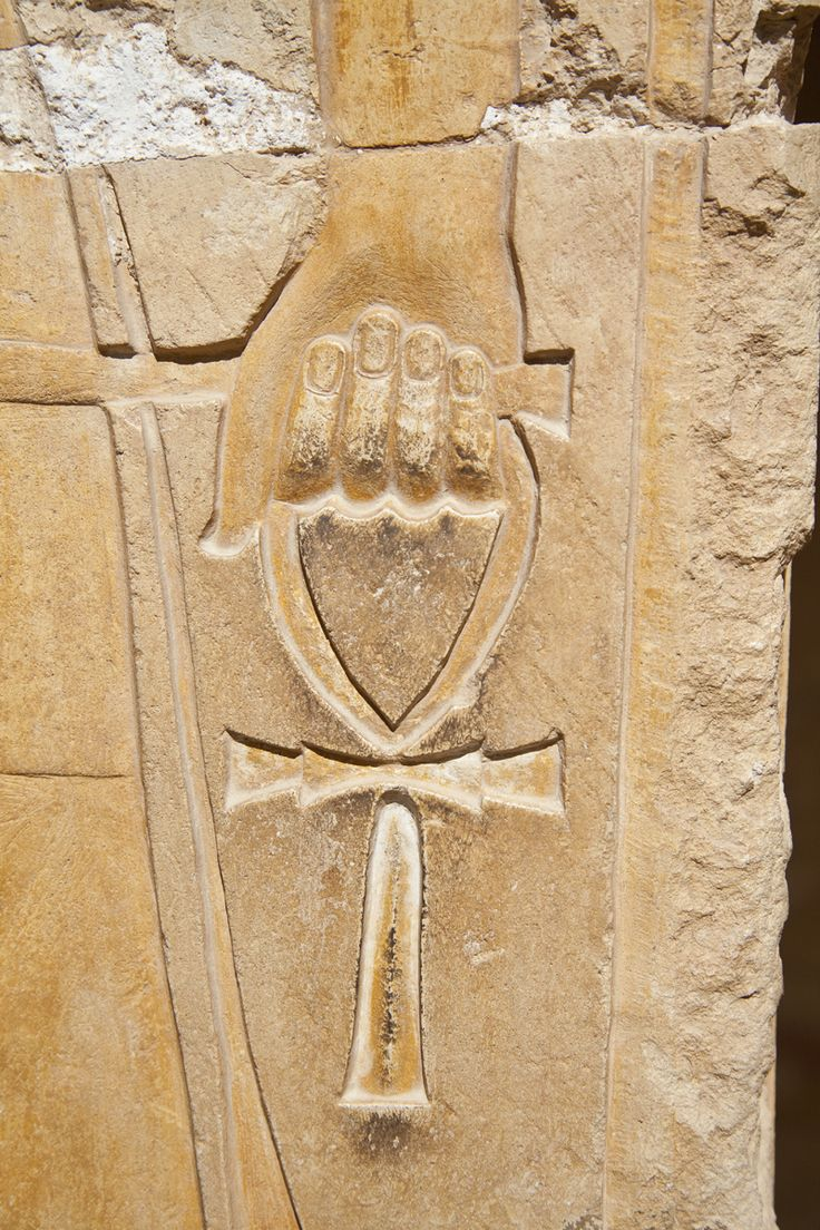 """The ankh, also known as key of life, was the ancient Egyptian hieroglyphic character that read """"eternal life"""". Egyptian gods are often portrayed carrying it by its loop, or bearing one in each hand, arms crossed over their chest."""
