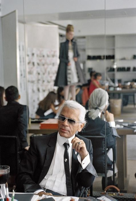 Karl Lagerfeld overseeing the fitting of an outfit from Chanel Fall/Winter 2002 Haute Couture