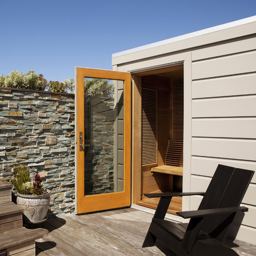 contemporary patio by Gast Architects- brick/stone wall for back patio