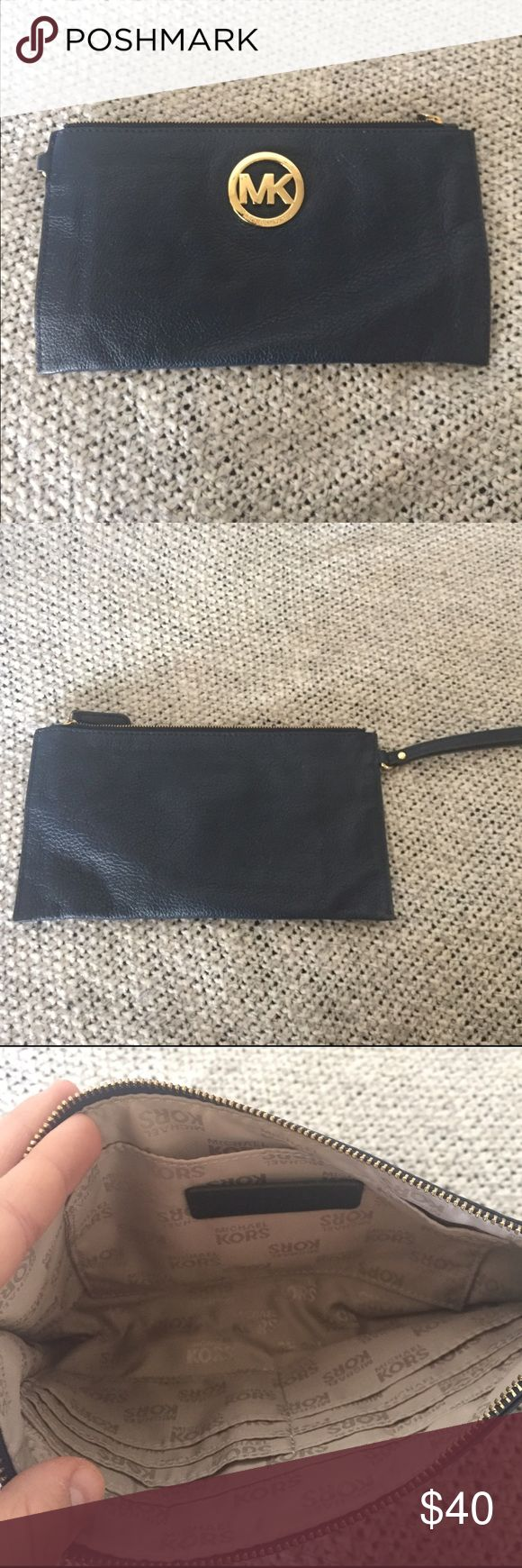Authentic Michael Kors navy clutch Small amounts of wrinkles from being stored, would go back to normal when used. The MK has minor scratches Michael Kors Bags Clutches & Wristlets