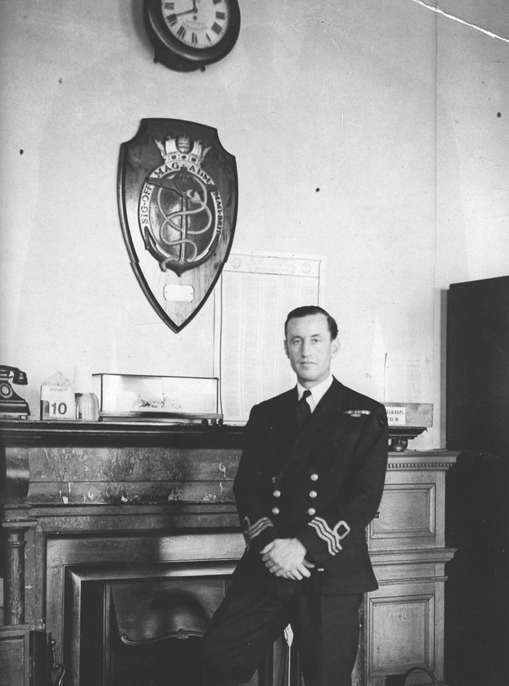 Commander Ian Fleming RNVR in Room 39 at the British Admiralty. As personal assistant and 'fixer' to both Directors of Naval Intelligence between 1939 and 1945, he knew many secrets and created a special force, 30 Assault Unit , to 'pinch' enemy...