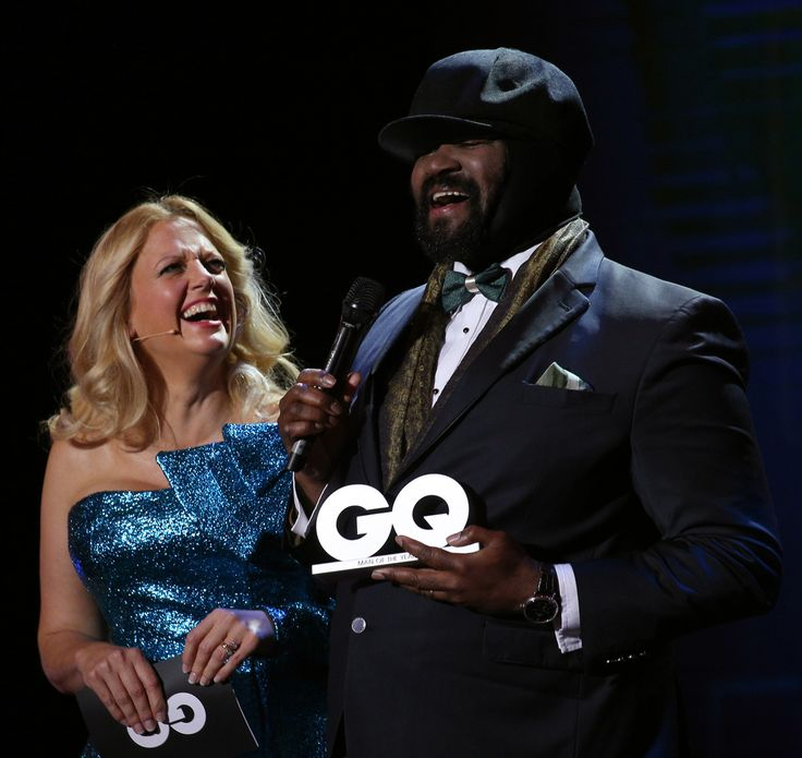 """Barbara Schoeneberger and award winner """"Music International"""" Gregory Porter are seen on stage at the GQ Men of the year Award 2017 show at Komische Oper on November 9, 2017 in Berlin, Germany.  (Photo by Gisela Schober/Getty Images for GQ)"""