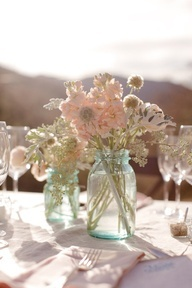 Blue tinted Mason jar with pink flowers. So cute!