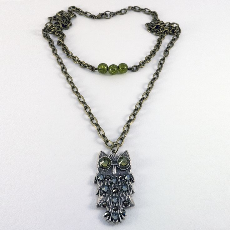 Beatrix: This pretty layered handmade necklace from EHJ has a built-in choker, clashing metallics and dazzling Swarovski crystals in olive green, smoky quartz and dark grey. Perfect for casual wear or as a statement piece this Christmas. A great gift for under the tree! Want it? Find it here: http://www.eleanorhalljewellery.com/collections/necklaces/products/beatrix-1 #Owl #Jewellery #ChristmasGifts