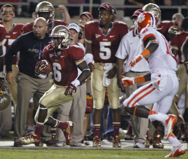 Florida State defensive back Nick Waisome (6) returns an interception 19 yards as Clemson wide receiver Jaron Brown (18) gives chase in the fourth quarter. (AP Photo/Phil Sears)