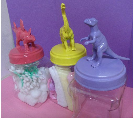 These lovely baby girl colored dinosaur jars can hold anything, from nursery supplies, to kids toys, baby shower trinkets, kitchen supplies, food, etc...the ideas are endless! They are made from a durable plastic and hand painted. The lids have a slight dino egg type texture to them. This listing is for the above seen trio, in lavender, pink, and yellow.   If your nursery or shower colors are different, or you need these jars for a baby boy, I can customize the jars to fit your needs! Please…