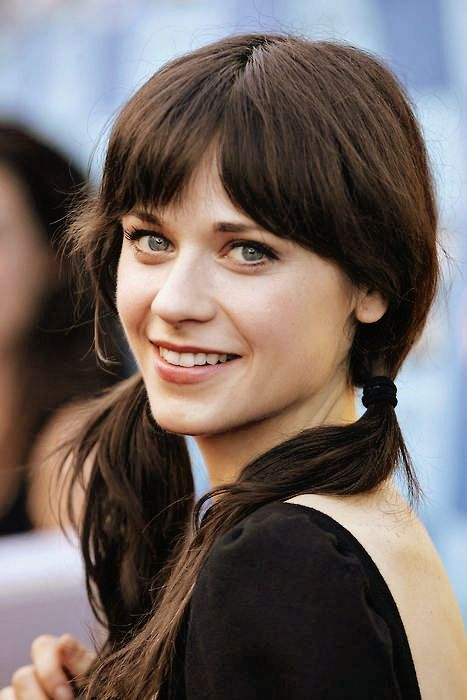 zooey-deschanel. i am way obsessed with her and her beautiful hair. i can't decide whether to medium bob or just keep the length and get bangs...