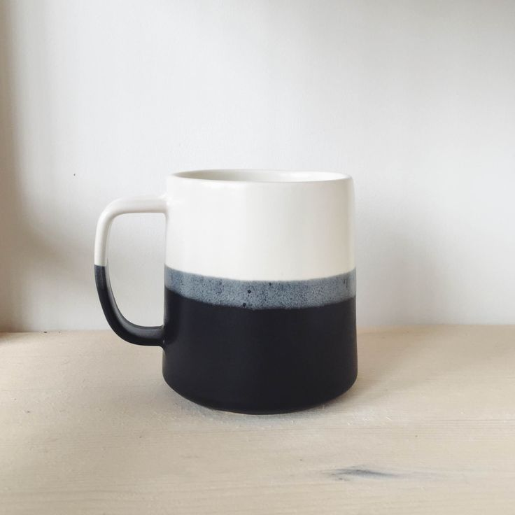 Brit's best-selling black mug is inspired by modern Scandinavian design. This black color-dipped handmade coffee mug is just what you need to start off your mornings or reflect during the evenings wit
