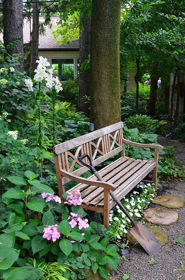 Love the flowers growing under the bench.