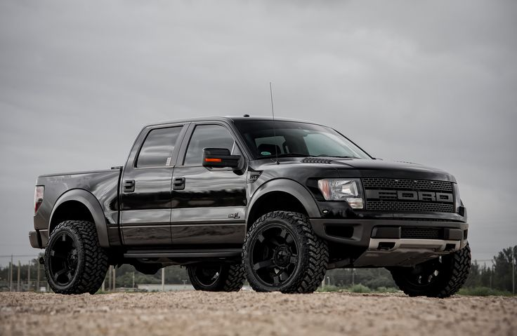 Customized Ford F150 SVT Raptor Black With Suspension Leveling Wallpaper Wallpaper