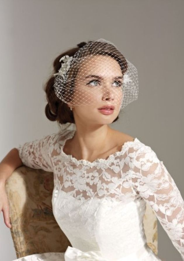 the birdcage veil trend goes back to the team the netting with feathers vintage brooches or clips for