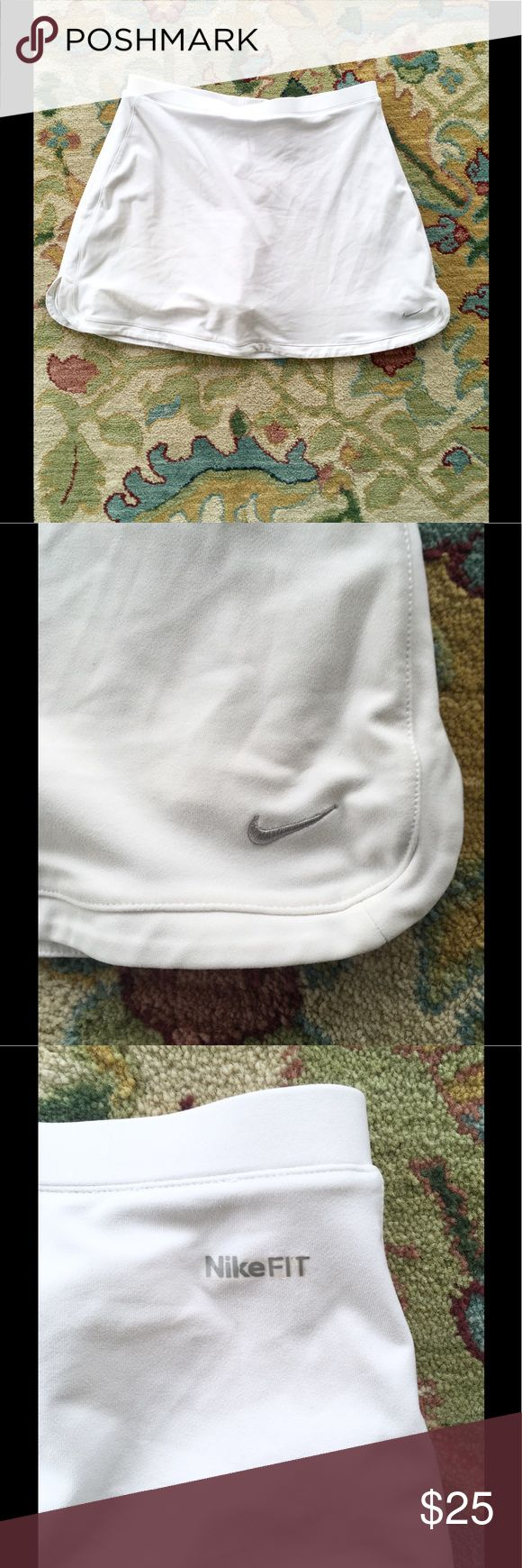 🎀 NIKE DRI FIT TENNIS SKIRT SKIRT w/Shorts 🎀 Ready for the US OPEN TENNIS?  Elegant White NIKE DRI-FIT TENNIS SKIRT SKORT w attached Shorts. Nike Swish Logo. Size XL label Fits 12 14. In fine gently worn condition. Pair with my listed Ralph Lauren Polo. Nike Skirts