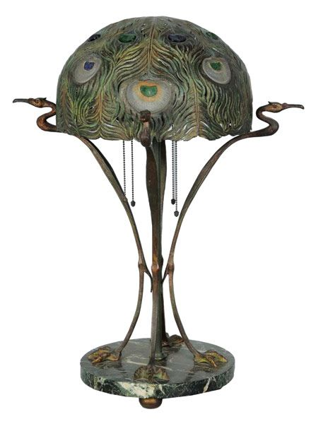 Four-peacock lamp ::  Gracefully styled on variegated green-marble base, with reticulated bronze shade inset with jeweled peacock-feather glass shade – estimate $3,000-$4,000. Image courtesy Morphy Auctions.