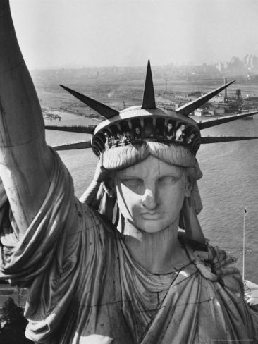 Sightseers Hanging Out Windows in Crown of Statue of Liberty with NJ Shore in the Background by Margaret Bourke-White. Photographic print from Art.com.