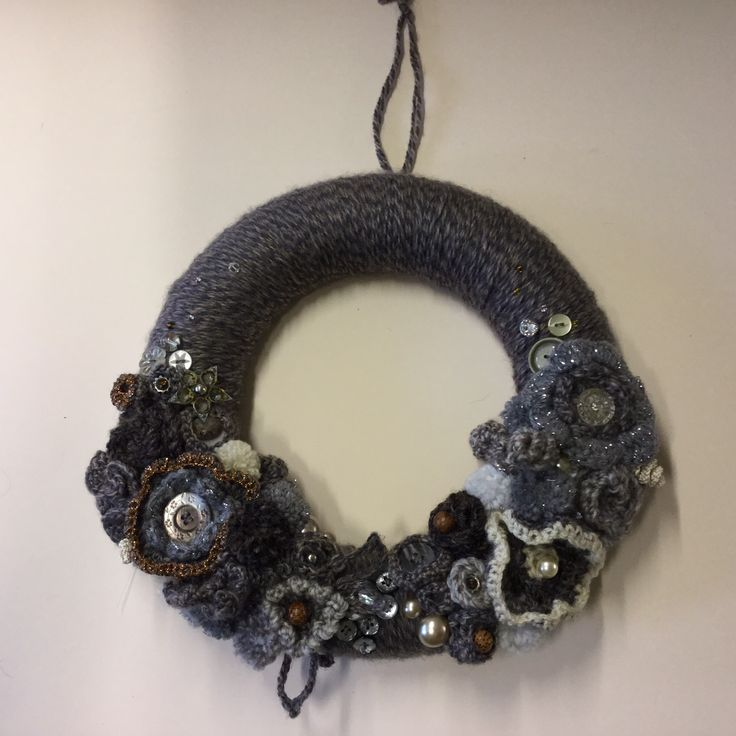 Steampunk wreath with old buttons and beautiful beads.