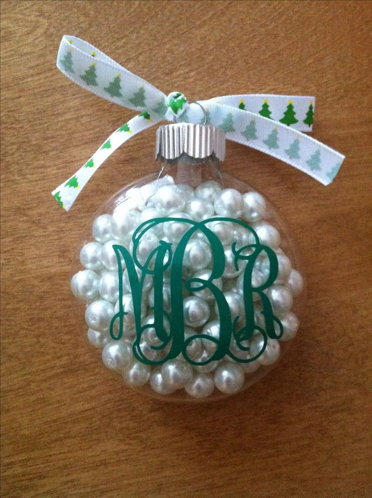DIY Monogram Christmas Ornament :) I love this idea because you can really personalize it by playing around with the color scheme to whatever your taste is or for families use a different color for each one made.