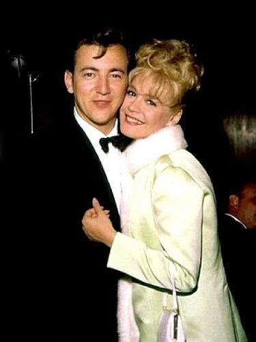 Bobby Darrin & Sandra Dee.  Fabulous singer and georgeous actress, I loved them both.  Probably my favorite couple from long ago. They got married   Dec 1, 1960.