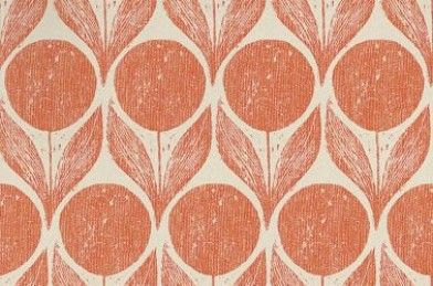Suvi  - Inspired by a 1950's Scandinavian block print, this wallpaper shows flowers and large leaves. Shown here in blossom clementine and taupe.