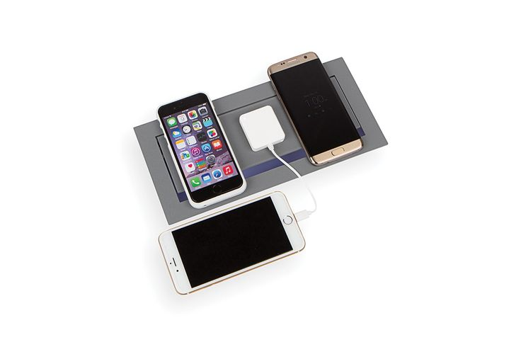 Wireless Charging on top, two electrical outlets rated 15A/125VAC and two dual USB charging ports underneath. Lid flips up to access your interior power and stays propped open, or lays flat with a gap across the front edge to run cables out while in use. The lid offers three charging stations for qi-compatible mobile devices. Charge up to three phones or tablets at once! Target locations for charging signified by the three crosshairs for pinpointed accuracy.