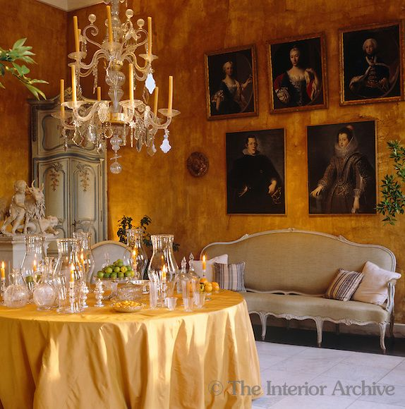 Axel Vervoordt A Series Of And Century Portraits Hangs On The Wall This Yellow Dining Room Table Is Filled With Collection Candlesticks