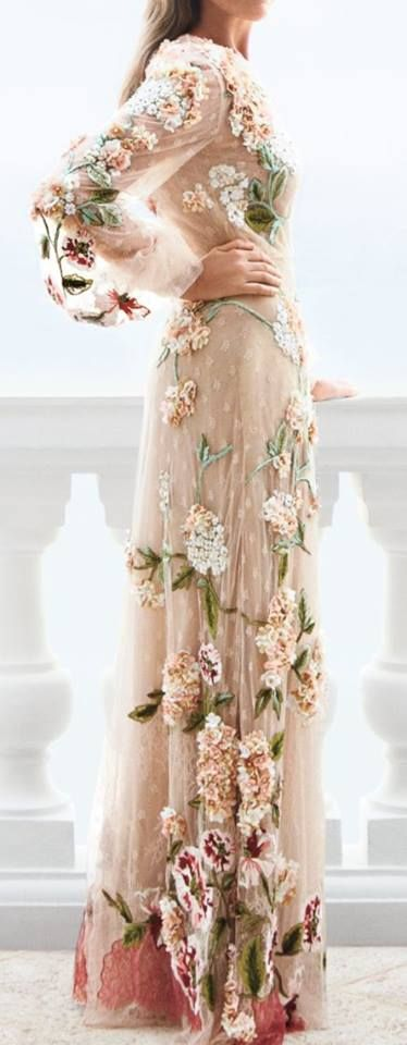 soft, flowing dress with 3-D flowers