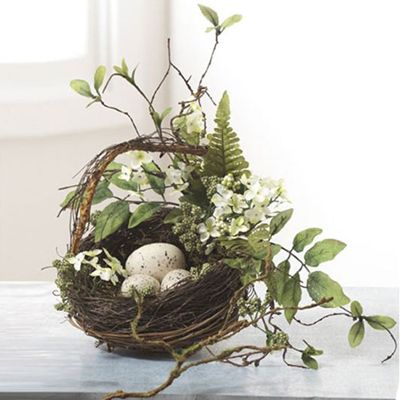 """RAZ Twig Nest Basket with Eggs Brown, Green, Cream Made of Grapevine/Polyester Measures 8"""" X 9"""" Nest basket fashioned out of twig, bits of greenery and plastic eggs."""