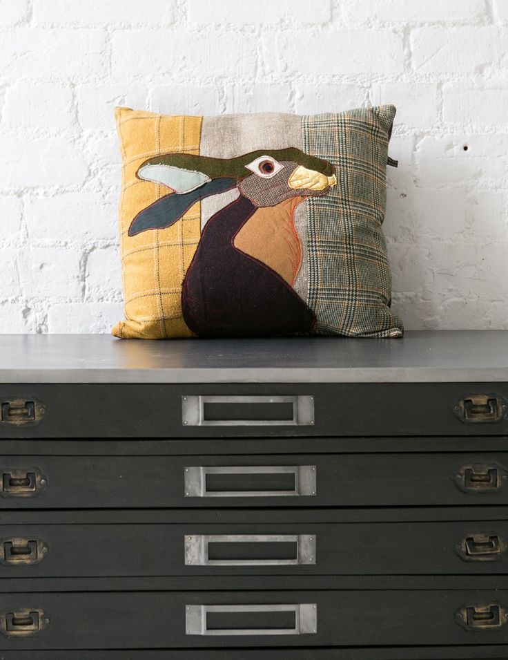Rose and grey cushions £75 each There is also a pheasant and squirrel version