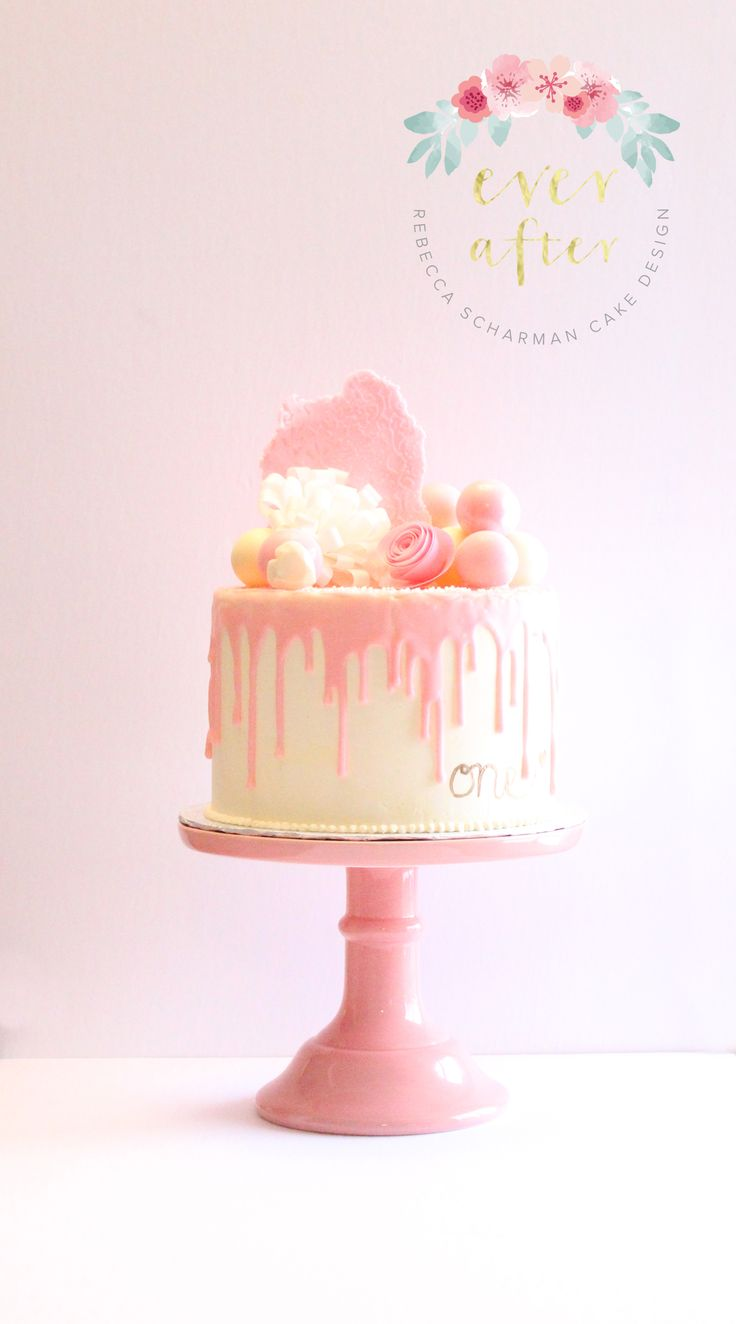 @everaftercake A gourmet drip cake for a first birthday. All decorations on top of the cake are edible and hand crafted.