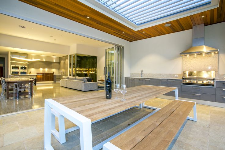 Outdoor alfresco kitchen with stainless steel bbq & rangehood feat. Louvretec roofing system  Desyn Homes Unley project