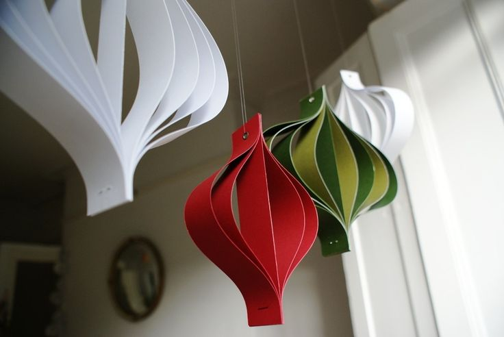 Paper Christmas decorations large red white and green hanging geometric curves. $25.00, via Etsy.