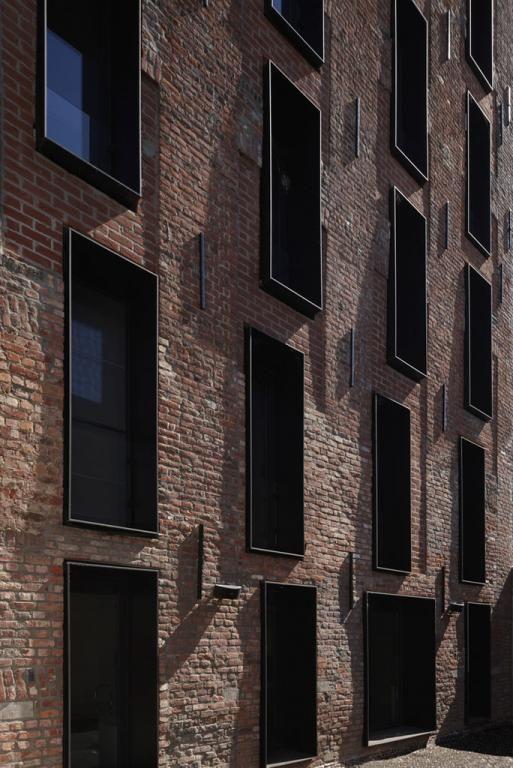 Clean windows in brick wall.