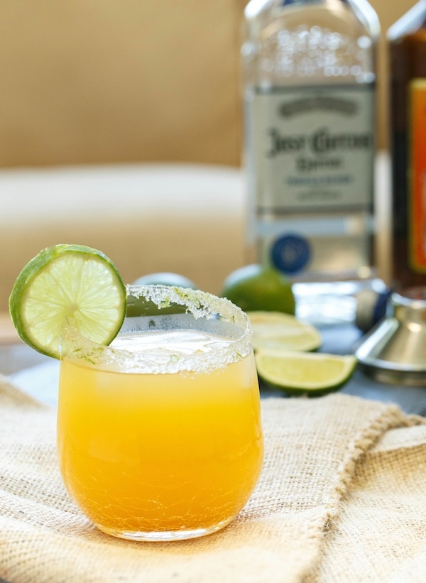 Simple Peach Margarita.  Spend less time behind the bar and more time with friends with this quick and easy foolproof recipe!