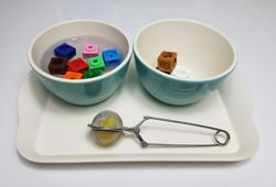 Transferring Ideas: using tea tongs to transfer beads out of a bowl of water