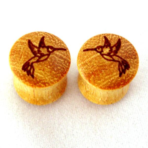 Hummingbird Osage Orange Wooden Plugs 00g (9mm) (10 mm) 7/16 (11mm) 1/2 (13mm) 9/16 (14mm) 5/8 11/16 3/4 7/8 1 1 1/8 Ear Gauges. $34.00, via Etsy.