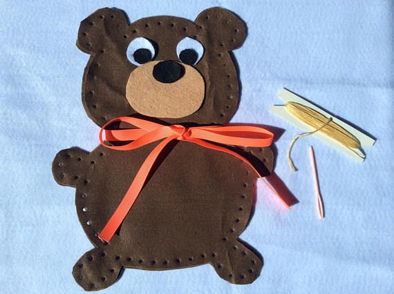 Teach your child to sew using this fun and easy teddy bear kit. Contains: felt bear pieces, felt face pieces, ribbon for decoration, large blunt wool needle and embroidery thread for sewing up. Just add scraps or polyfill for stuffing. The kit also includes easy to follow instructions. Your child only has to sew together a front and back. The wool needle is large and does not have a sharp point. Use existing holes to sew safely. All trims can be glued on after sewing. The doll is made of…
