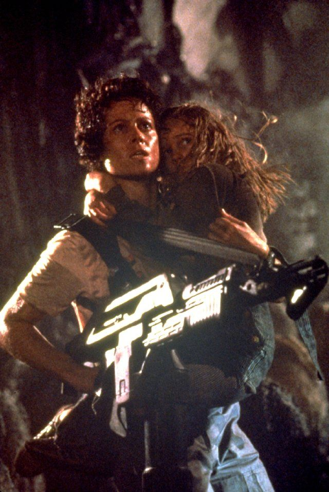 "Ripley saves Newt in ""Aliens"". Played by Sigourney Weaver and Carrie Henn."