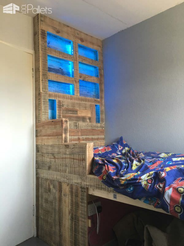 #Bed, #Bedroom, #HomeDécor, #Kids, #PalletBed, #PalletDiyIdeas, #PalletFurniture, #PalletHeadboard, #PalletWall, #RecyclingWoodPallets, #RepurposedPallet How about this super-fun Raised Pallet LED-Lit Kids Bed for your own DIY Pallet Project? I turned a little built-in area in my kid's room into a platform bed with a large headboard and under bed storage. To make it more unique, I added blue LED
