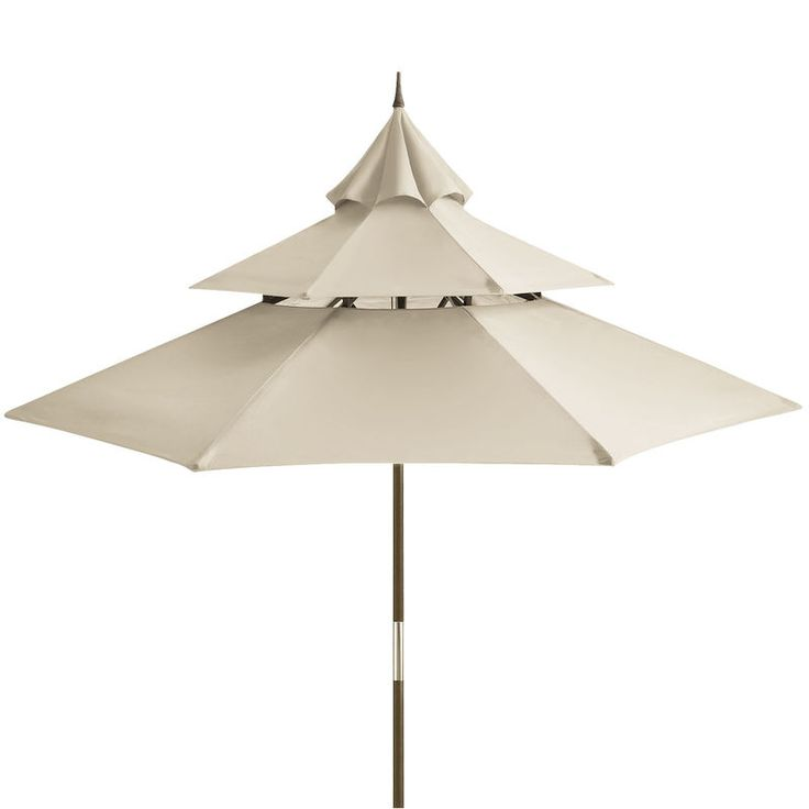 Inspired by the tiered roof lines of Asian architecture, our outdoor umbrella features a tiered, colorfast, water-repellent canopy in the calming hue of pure beach sand. Underneath, a pulley design makes for easy opening, and the eucalyptus pole assembles simply and provides lasting stability. Includes drawstring storage tote.