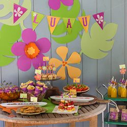 These free Luau party printables include everything you need to host a DIY tropical party including cupcake toppers, banners, & treat labels
