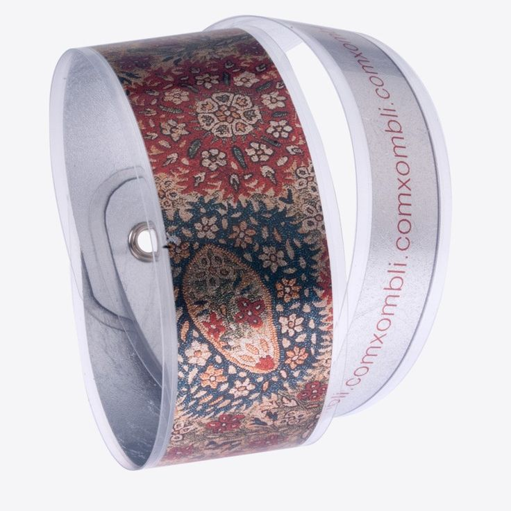 Digitally printed bracelet with traditional Greek embroidery motifs. Made of silver leaf and plastic film. Stamatis Zannos designs jewels inspired by the contemporary Greek civilization as it is showcased in museums. Zannos has presented his work in several venues, including the Benaki Museum in Athens.