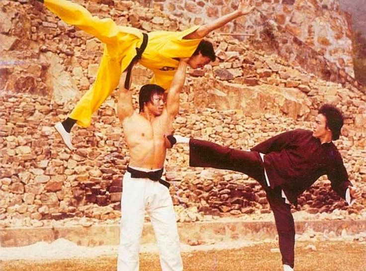 Greatest Martial Arts photo ever Bolo Yeung vs. Bruce Lee using Jackie Chan as a weapon..