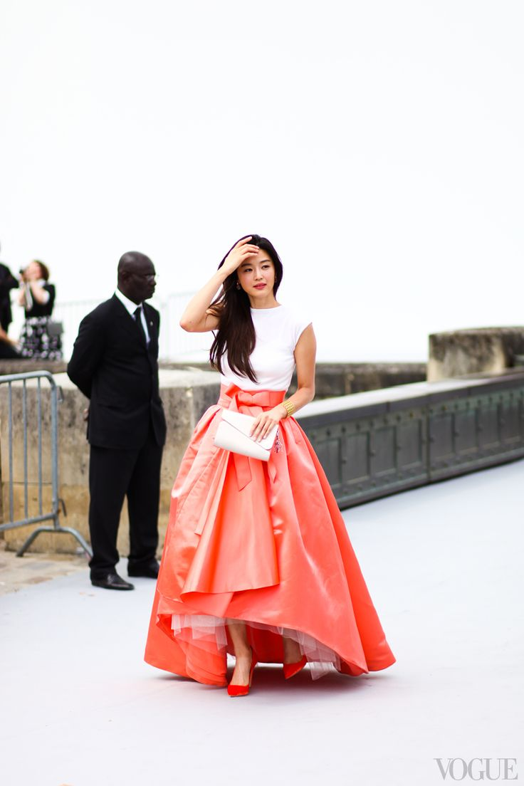 "This is the ultimate look for the couture—it puts you in the  mood even before entering a show. The big ball skirt paired with a simple T-shirt top is a very ""Raf Simons for Dior"" take on couture—very modern. J'adore. - Photographed by Leslie Kirchhoff"